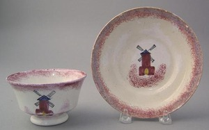 Red spatter cup and saucer in the windmill pattern