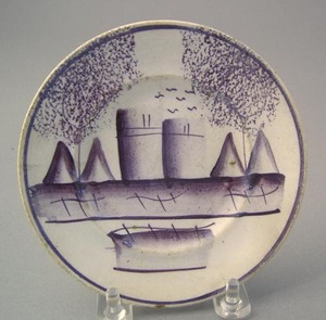 Purple spatter toddy plate in the castle pattern,