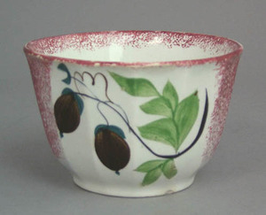 Red spatter paneled waste bowl with brown acorns,