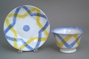 Yellow and blue rainbow cup and saucer in the star