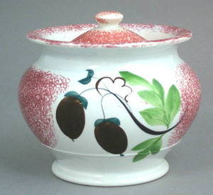 Red spatter ovoid covered sugar with brown acorns,