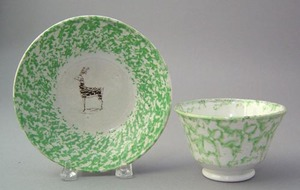 Green spatter cup and saucer, the saucer with tran