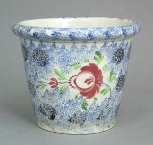 Blue spatter flowerpot with black spatter splotche