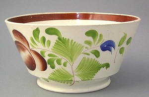 Staffordshire bowl with red and blue rose decorati