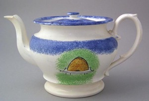Blue spatter round teapot with double sided yellow