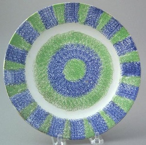 Green and blue rainbow spatter plate with bullseye