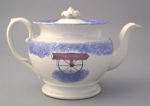Blue spatter round teapot with double sided cannon