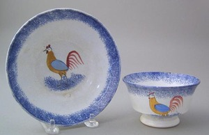 Blue spatter handleless cup and saucer with yellow