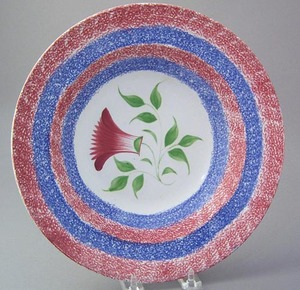 Vibrant red and blue rainbow spatter bowl with thi