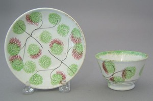 Miniature red and green spatter cup and saucer inh