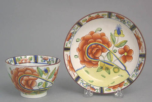 Gaudy Dutch cup and saucer in the oyster pattern.