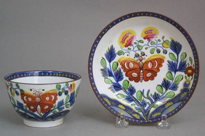 Gaudy Dutch cup and saucer in the butterfly patter