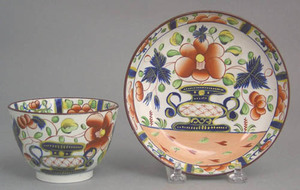 Gaudy Dutch cup and saucer in the urn pattern.
