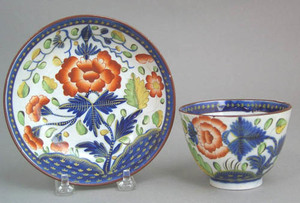 Gaudy Dutch cup and saucer in the carnation patter
