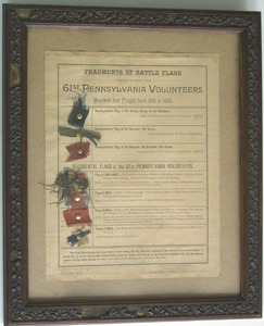 Framed fragments of Civil War battle flags under w