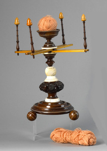 Finely carved maple, rosewood and ivory wool winde