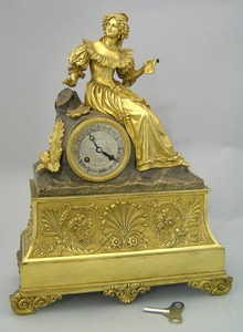 French brass mantle clock, late 19th c., with a yo