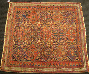 Caucasian throw rug, ca. 1920, with overall geomet