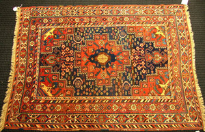 Caucasian throw rug, ca. 1915, with a central meda