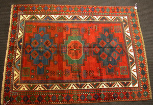Kazak throw rug, ca. 1910, with 3 medallions on aa