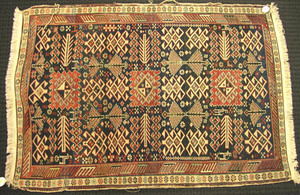 Shirvan throw rug, ca. 1910, with geometric design