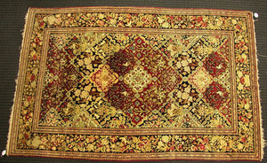 Kirman throw rug, ca. 1910, with a central rust me