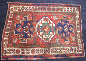 Kazak mat with 3 central medallions on a brick red