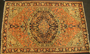 Sarouk throw rug, ca. 1920, with a central navy me