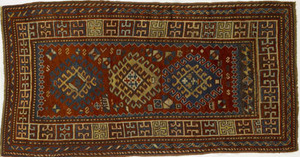 Kazak throw rug, ca. 1915, with 3 central medallio