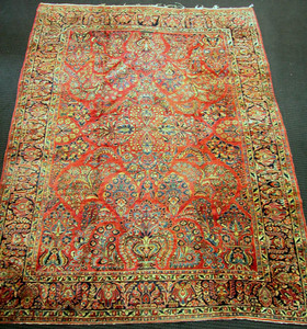 Sarouk rug with wine field and overall floral patt