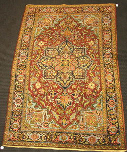 Heriz rug, ca. 1940, with a central medallion on a