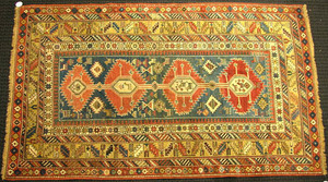 Shirvan throw rug, ca. 1900, with 4 central red me