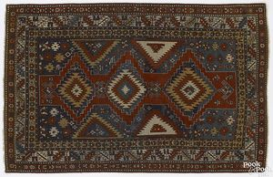 Vibrant Kazak throw rug, ca. 1900, with 3 centrale