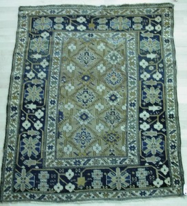 Daghestan throw rug, ca. 1910, with a repeating fl