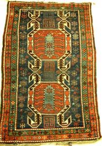 Daghestan throw rug, ca. 1910, with 2 central meda