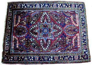 Sarouk mat, ca. 1920, with overall floral motif on