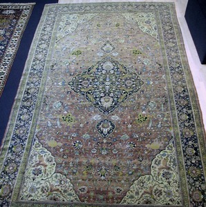 Room-size Indo-Tabriz rug, ca. 1920, with a centra
