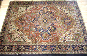 Room-size semi-antique Heriz rug with central coba