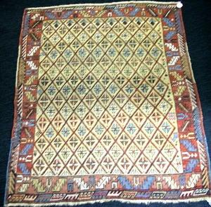 Shirvan throw rug, ca. 1900, with an overall diamo