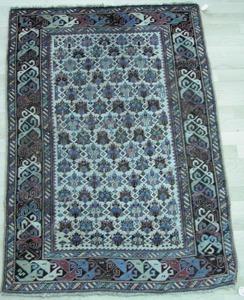 Kuba throw rug, ca. 1900, with repeating church de