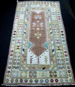 Turkish prayer rug, ca. 1900, with an oxblood mihr