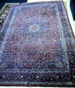 Semi-antique Tabriz room-size rug with a central c