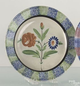 Pair of blue and green spatter creamware plates wi