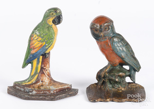 Two cast iron bird doorstops