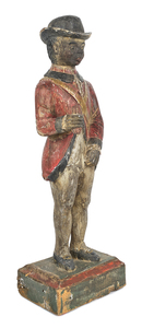 Carved and painted pine figure of a black soldier,