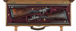 Cased pair of James Purdey & Sons side lock double