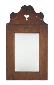 Pennsylvania walnut mirror, ca. 1800, with a heart