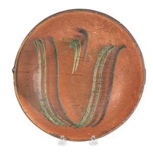 Pennsylvania redware pie plate, 19th c., attribute