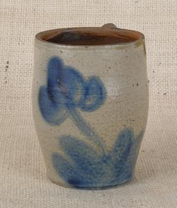 Pennsylvania stoneware mug, 19th c., attributed to
