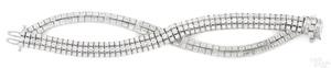 18K white gold and diamond cross-over bracelet